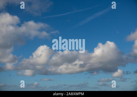 Broken white cloud cloudscape in natural pattern on an autumn sunny day - Stock Photo