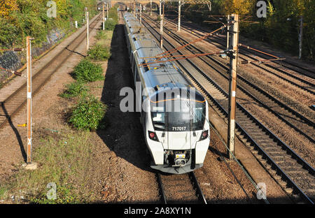 Class 717 suburban EMU forms a local passenger train heading north from Finsbury Park, London, England, UK - Stock Photo