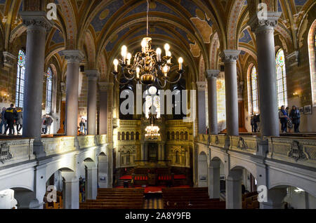 Pilsen, Czech Republic - Oct 28, 2019: Interior of the Great Synagogue. The second-largest synagogue in Europe. Photographed from the balcony. Pillars and arches, ceiling. People on the tours. - Stock Photo
