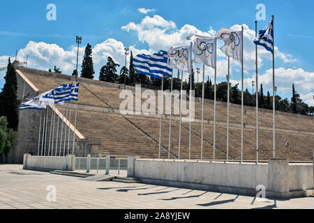 Athens, Greece, Jun 04, 2016. View of the old Olympic stadium in Athens and flags fluttering. - Stock Photo