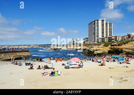 Beachgoers enjoying a beautiful sunny day at La Jolla Cove in San Diego, California, USA. August, 22nd, 2019 - Stock Photo