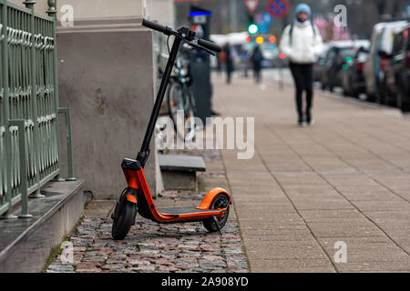 An electric scooter parked on the sidewalk in Riga, Latvia - image - Stock Photo