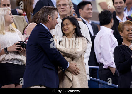 Queens, United States Of America. 30th Aug, 2011. NEW YORK, NY - AUGUST 29: Alec Baldwin (L) and Hilaria Thomas attend the opening ceremony during Day One of the 2011 US Open at the USTA Billie Jean King National Tennis Center on August 29, 2011 in the Flushing neighborhood of the Queens borough of New York City. People: Alec Baldwin_Hilaria Thomas Credit: Storms Media Group/Alamy Live News - Stock Photo