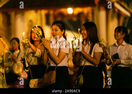 Vientiane, Laos. 11th Nov, 2019. People take part in a candlelight parade surrounding the That Luang during the That Luang Festival in Vientiane, Laos, Nov. 11, 2019. The That Luang Festival, the most important religious festival in Laos, concluded on Nov. 11 with lots of people holding a candlelight parade surrounding the That Luang in Vientiane. Credit: Kaikeo Saiyasane/Xinhua/Alamy Live News - Stock Photo