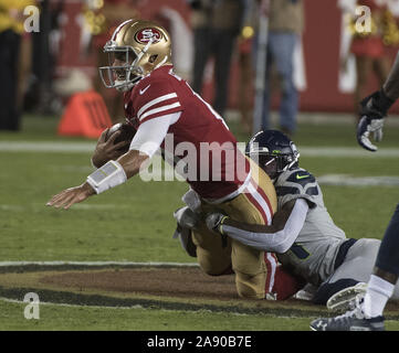Santa Clara, California, USA . 11th Nov, 2019. San Francisco 49ers quarterback Jimmy Garoppolo (10) is sacked by the Seattle Seahawks in the first quarter at Levi's Stadium in Santa  Clara, California on Monday, November 11, 2019. The Seahawks defreated the 49ers 27-24 in overtime.    Photo by Terry Schmitt/UPI Credit: UPI/Alamy Live News - Stock Photo