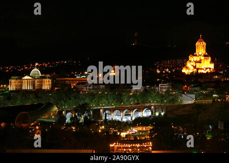 Beautiful Cityscape of Tbilisi at Night with the Presidential Palace and the Holy Trinity Cathedral of Tbilisi, Georgia - Stock Photo