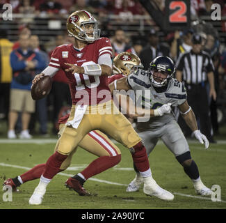 Santa Clara, California, USA . 11th Nov, 2019. San Francisco 49ers quarterback Jimmy Garoppolo (10) throws against the Seattle Seahawks in the third quarter at Levi's Stadium in Santa  Clara, California on Monday, November 11, 2019. The Seahawks defreated the 49ers 27-24 in overtime.    Photo by Terry Schmitt/UPI Credit: UPI/Alamy Live News - Stock Photo
