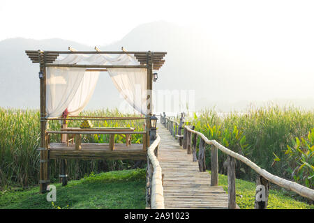 The resting huts constructed from bamboo and thatched roofs for relaxing - Stock Photo