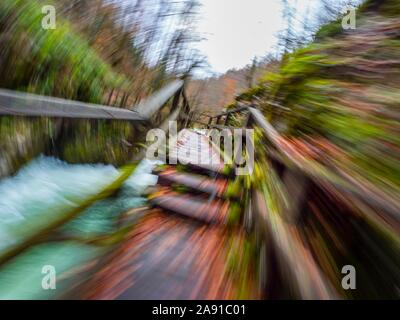Wooden pathway in Kamacnik canyon near Vrbovsko in Croatia Europe intentionally blurry representing maximum utmost speed speedy fast movement - Stock Photo