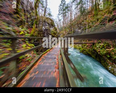 Wooden pathway in Kamacnik canyon near Vrbovsko in Croatia Europe intentionally blurry representing speed speedy fast movement - Stock Photo