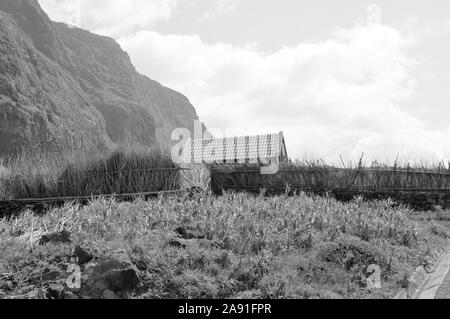 An isolated house in a rural place with a straw fence (Madeira, Portugal, Europe) - Stock Photo