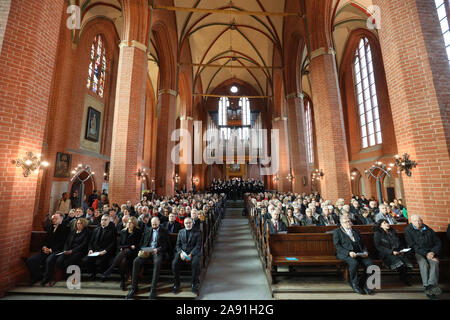 Rostock, Germany. 12th Nov, 2019. Participants of an ecumenical celebratory service sit in the university church. The 600th founding day of the University of Rostock is ushered in with an ecumenical service in the University Church. Credit: Danny Gohlke/dpa/Alamy Live News - Stock Photo