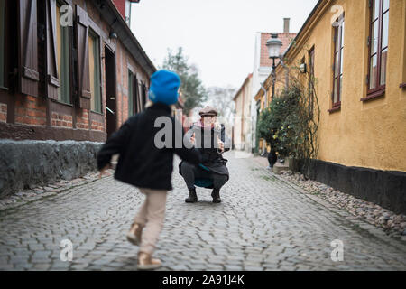 Father with daughter on cobblestone street Stock Photo