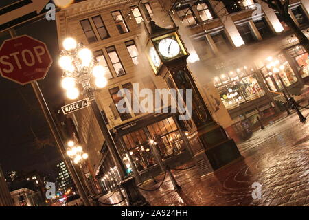 The vintage steam clock on the corner of Water Street and Cambie Street in historic Gastown in downtown Vancouver, Canada, 2013, at night time, Winter - Stock Photo