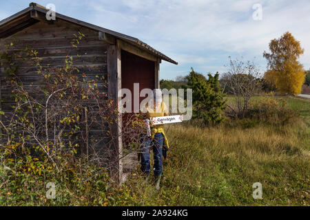 Woman standing near wooden shed - Stock Photo
