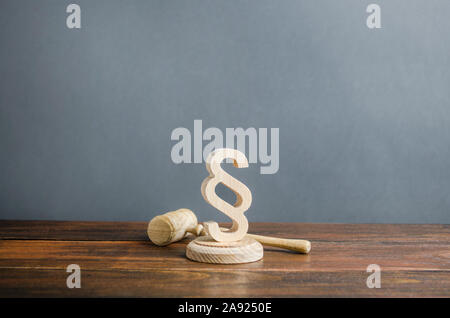Paragraph figurine and judge's gavel. Justice and judicial system concept. Legal assistance, services of lawyers. Democratic institutions, human right - Stock Photo