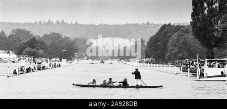 Henley, GREAT BRITAIN, A Punt ferrying people and an old gramophone across  the Henley Regatta course, with a race in progress, 1982, Henley Royal Regatta, Henley on Thames England, [Mandatory Credit Peter Spurrier/Intersport Images] - Stock Photo