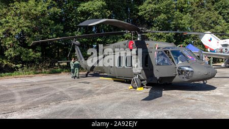 OSTRAVA, CZECH REPUBLIC - SEPTEMBER 22, 2019: NATO Days. An UH-60 Black Hawk helicopter of the Slovak Air Force on static display. Aircrew checks heli Stock Photo