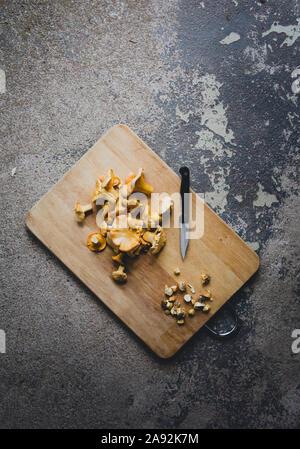 Mushrooms on chopping board - Stock Photo