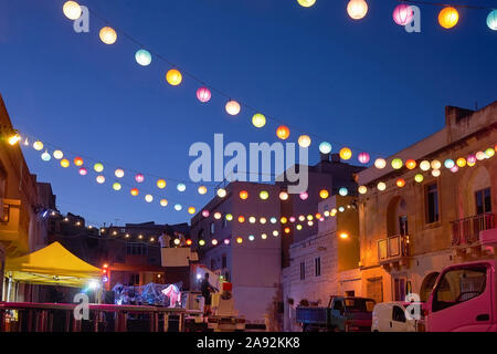 City street decorated with glowing colored lanterns to celebrate festival Ramadan, Indian diwali celebration - Stock Photo