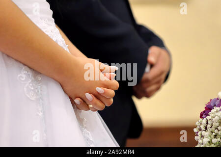 Bride  and groom at church wedding  ceremony - Stock Photo