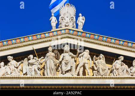 Statues of the Greek god Zeus seated on a throne flanked by Pallas Athena, Apollo and Hera on the gable of the Academy in Athens, Greece - Stock Photo