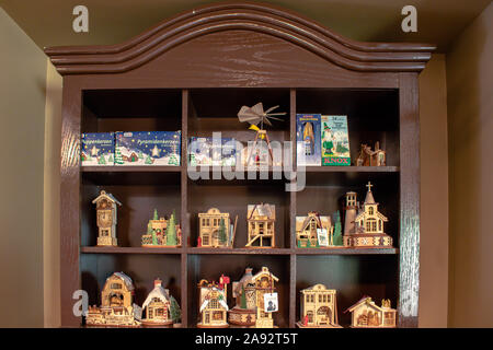 Christmas village wooden ornaments in store - Stock Photo