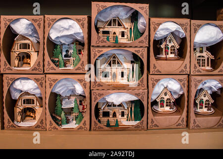 Small wooden houses of Christmas village in store - Stock Photo