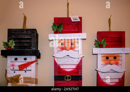 Wooden Santa Claus ornament in store - Stock Photo