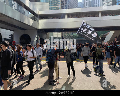 Central/Hong Kong- 11 November 2019: the protester hold the flag ' Liberate Hong Kong, the revolution of our times' in central. after the anti mask law is launched, the protests is never end. - Stock Photo