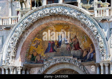 The stunning mosaic above the main entrance to the historic St. Marks Basilica in the city of Venice in Italy.