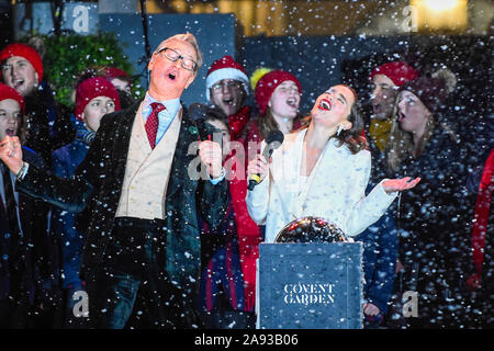 London, UK.  12 November 2019.  Paul Feig (L), Last Christmas movie director, Emilia Clarke (R), Last Christmas movie actress,  on stage during the annual Christmas lights switch-on Covent Garden.  Credit: Stephen Chung / Alamy Live News - Stock Photo