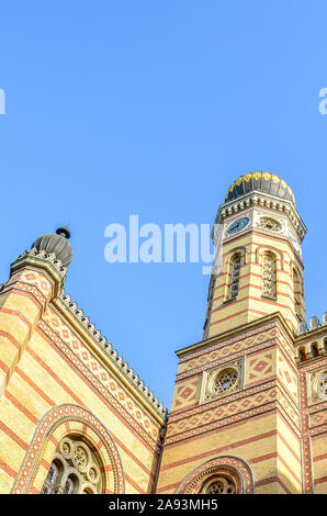Vertical photo of the Great Synagogue in Budapest, Hungary. Known also as Dohany Street Synagogue, the largest synagogue in Europe. Centre of Neolog Judaism. Ornamental facade and a onion dome. - Stock Photo