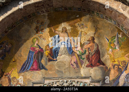 A stunning mosaic above the main entrance to the historic St. Marks Basilica, in the city of Venice in Italy.