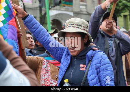 La Paz, Bolivia. 12th Nov, 2019. Supporters of the former president of Bolivia, Evo Morales, demonstrate in La Paz, Bolivia 12 November 2019, carrying the Whipala, a flag that represents the country's indigenous. Credit: Martin Alipaz/EFE/Alamy Live News - Stock Photo