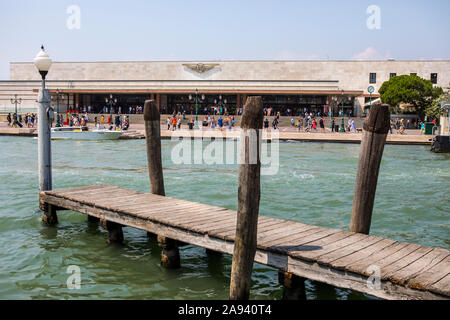 Venice, Italy - July 21st 2019: View across the Grand Canal of the exterior of Venezia Santa Lucia Railway Station in the city of Venice, Italy. - Stock Photo