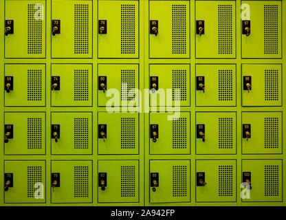 Green lockers in 4 rows, with locks and keys; Lugano, Ticino, Switzerland