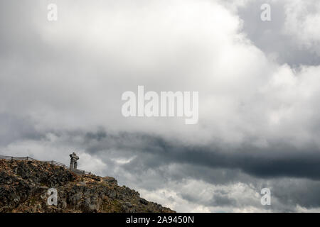 An Inukshuk sits on the top of Whistler Mountain in British Columbia Stock Photo