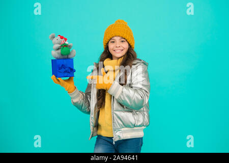 Rat symbol year. 2020 rat year. It has characteristics of animal with spirit wit alertness delicacy flexibility and vitality. Girl child hold gift box with rat or mouse toy. Chinese horoscope concept. - Stock Photo
