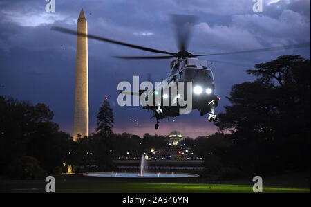 Washington, United States. 12th Nov, 2019. Marine One carrying President Donald Trump and First Lady Melania Trump lands at dusk on the South Lawn as they return to the White House, Tuesday, November12, 2019, in Washington, DC. Trump spent a long Veteran's Day weekend in New York City. Photo by Mike Theiler/UPI Credit: UPI/Alamy Live News - Stock Photo