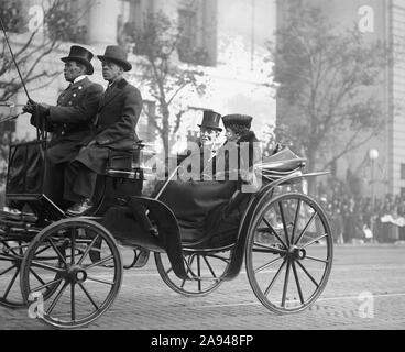 Former U.S President Woodrow Wilson and his Wife Edith Bolling Wilson Riding in Horse-drawn Carriage to Burial of Unknown Soldier, Armistice Day, Photograph by National Photo Company, November 11, 1921 - Stock Photo