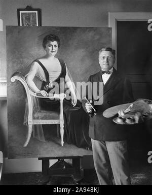 Artist Seymour M. Stone with Painting of First Lady Edith Bolling Wilson, Wife of U.S. President Woodrow Wilson, National Photo Company, 1920 - Stock Photo