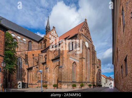 view of the southern transept and choir St. George's Church Wismar, a reconstructed medieval brick gothic architecture, which was substancially damage - Stock Photo
