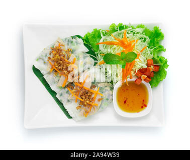 Rice flour Rolls Stuffed with ground pork and green onion ontop with Vietnamese Pork Saucesage Served with sweet dipping sauces  Vietnamese Food style - Stock Photo