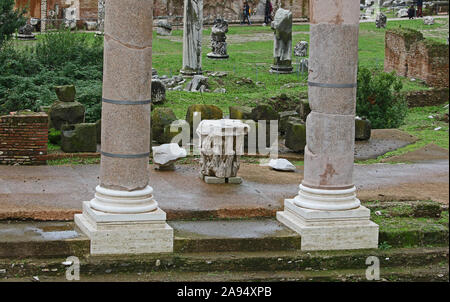 Remains of ancient Roman columns in the Forum of Augustus showing the bases of the columns with a Corinthian or Composite style capital between them - Stock Photo