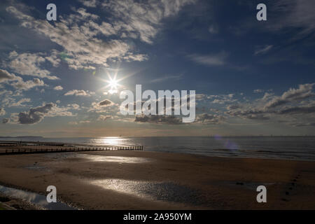 Sunset over the beach at Rhyl on the North Wales coast - Stock Photo