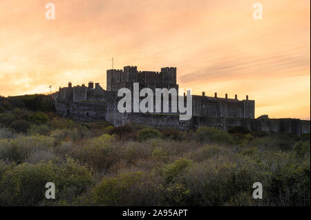 Dover Castle, Dover, Kent. The imposing medieval castle shot at sunset. - Stock Photo
