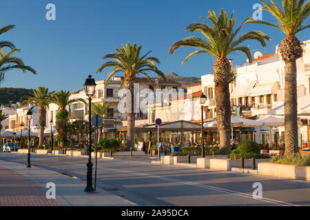 Rethymno, Crete, Greece. View along the palm-lined seafront promenade, sunrise.