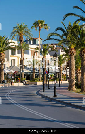 Rethymno, Crete, Greece. View along the palm-lined seafront promenade, early morning.