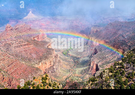 Rainbow above the Grand Canyon in Arizona, USA - Stock Photo